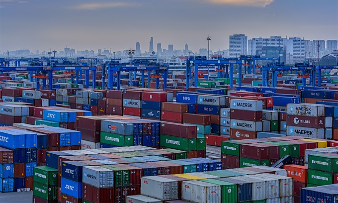 Shipping containers at a port in Ho Chi Minh City. Photo by Shutterstock/Igor Grochev.